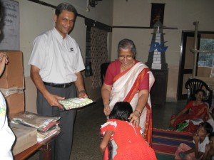 Gifting of Tees packed by SheepStop at the hands of Dr. Onawale of Deep Griha Society and Mr. Kevin Pinto of Cummins